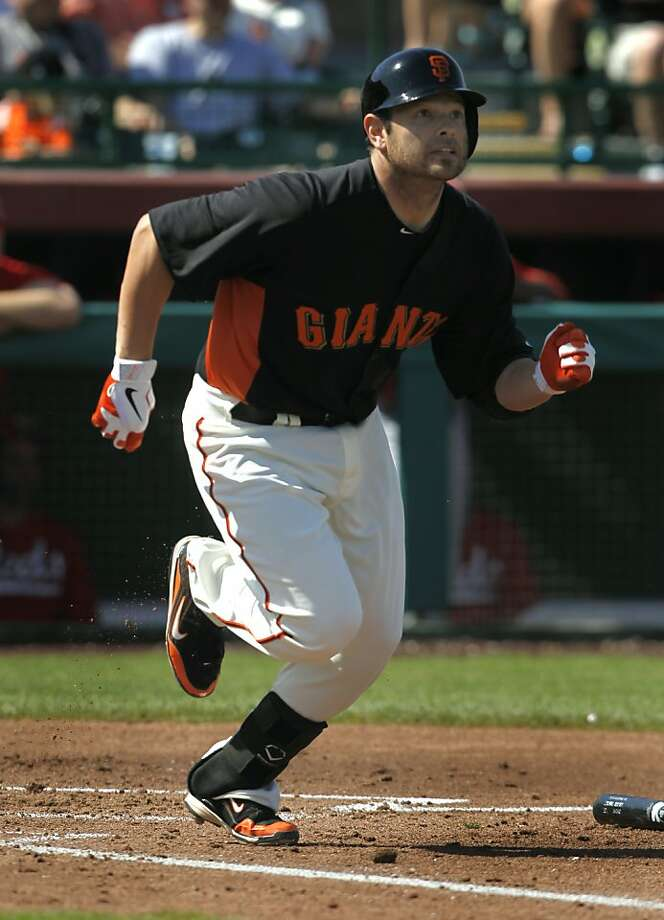 Freddy Sanchez rushes towards first base in the San Francisco Giants Cactus League spring training game against the Cincinnati Reds in Scottsdale, Ariz. on Friday, March 9, 2012. It was Sanchez's first game since his season-ending injury last year. Photo: Paul Chinn, The Chronicle