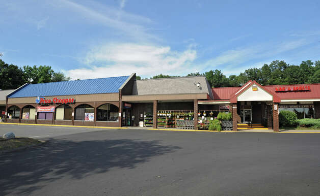 Exterior of the Price Chopper and Loudonville Wine & Spirits near the corner of Albany Shaker Rd. and Osborne Rd. Thursday, July 5, 2012 in Loudonville, N.Y. Price Chopper is proposing to expand by a third. The store would occupy space where Loudonville Wine & Spirits now is.  The liquor store will move into plaza in front closer to Albany Shaker Rd. (Lori Van Buren / Times Union) Photo: Lori Van Buren