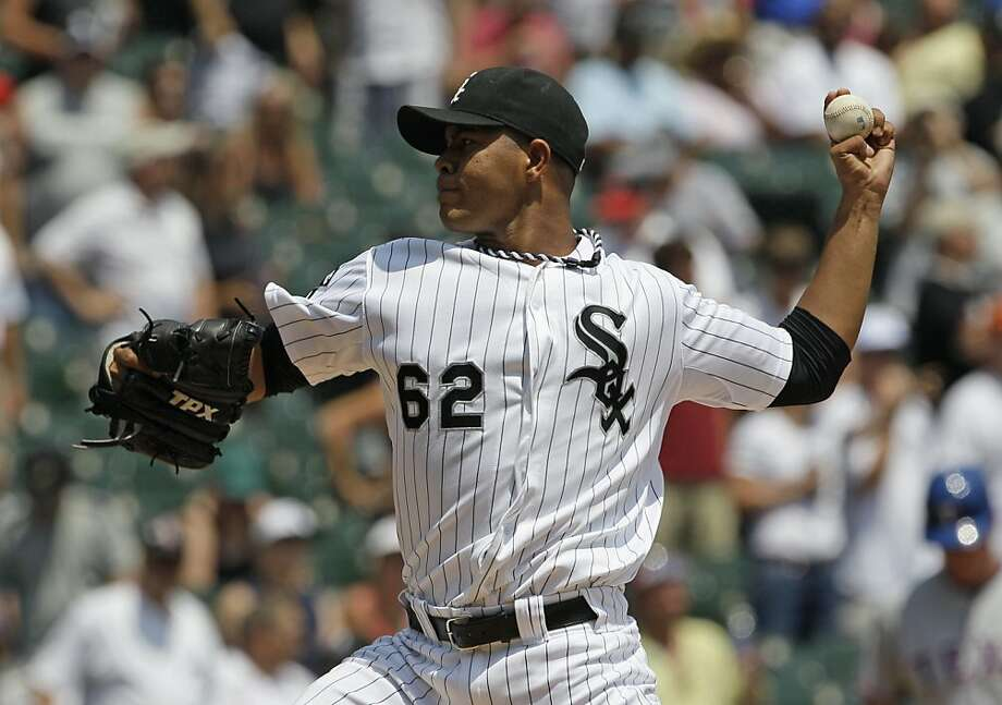 Chicago White Sox starter Jose Quintana throws against the Texas Rangers during the first inning of a baseball game in Chicago, Thursday, July 5, 2012. (AP Photo/Nam Y. Huh) Photo: Nam Y. Huh, Associated Press