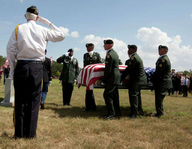 The casket of Lt. Col. Roy Tisdale is carried during the burial ceremony at the Aggie Field of Honor