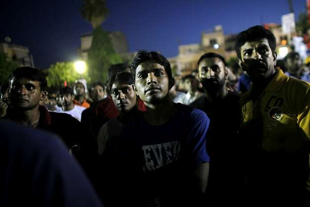 Immigrants take part in a demonstration against fascism in Athens on July 5, 2012. Hundreds of protesters, Greeks and immigrants, gathered in the working class area of Nikaia, near Athens, to protest against neonazi violence. AFP PHOTO / ANGELOS TZORTZINISANGELOS TZORTZINIS/AFP/GettyImages Photo: Angelos Tzortzinis, AFP/Getty Images