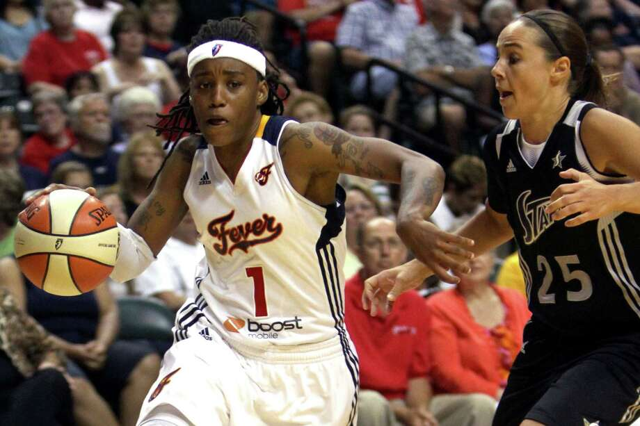 Indian Fever's Shavonte Zellous (1) drives around San Antonio Silver Stars defender Becky Hammon (25) during the second half of an WNBA basketball game, Thursday, July 5, 2012, in Indianapolis. Photo: AP Photo / The Indianapolis Star, Kenneth L. Hawkins Jr.