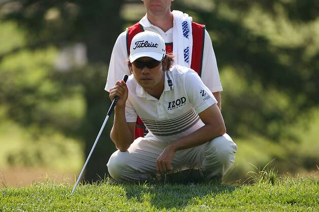 WHITE SULPHUR SPRINGS, WV - JULY 5: Kevin Na lines up his birdie putt on the sixth hole during the first round of the Greenbrier Classic at the Old White TPC on July 5, 2012 in White Sulphur Springs, West Virginia. (Photo by Hunter Martin/Getty Images) Photo: Hunter Martin, Getty Images