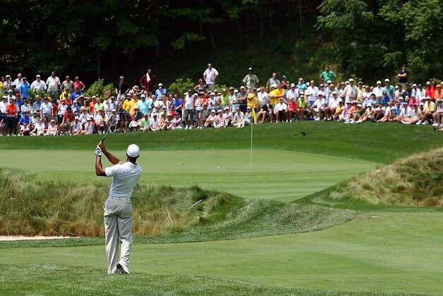 WHITE SULPHUR SPRINGS, WV - JULY 5: Tiger Woods hits his second shot on the ninth hole during the first round of the Greenbrier Classic at the Old White TPC on July 5, 2012 in White Sulphur Springs, West Virginia. (Photo by Hunter Martin/Getty Images) Photo: Hunter Martin, Getty Images