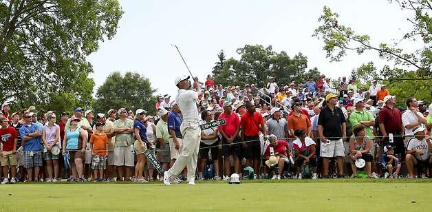 Tiger Woods tees off on the 18th hole during The Greenbrier Classic PGA Golf tournament in White Sulphur Springs, W.Va., Thursday, July 5, 2012. Woods finished the day at 1-over 71. (AP Photo/The Roanoke Times, Kyle Green) Photo: Kyle Green, Associated Press