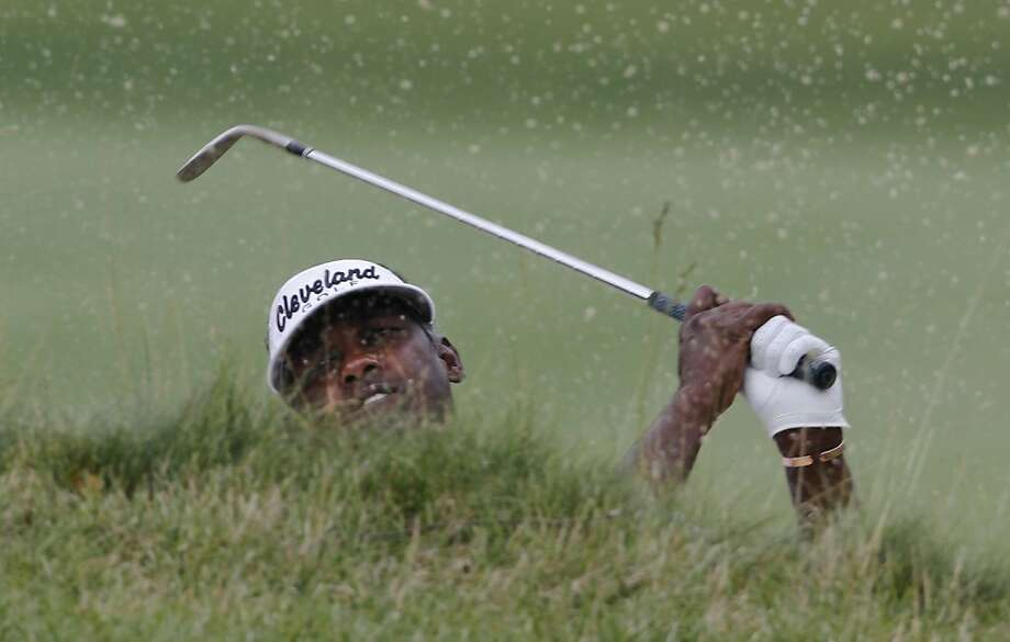 Vijay Singh, watches his sand shot on the 17th hole during the first round of the Greenbrier Classic PGA Golf tournament at the Greenbrier in White Sulphur Springs, W. Va., Thursday, July 5, 2012.  Singh finished 7-under-63. (AP Photo/Steve Helber) Photo: Steve Helber, Associated Press