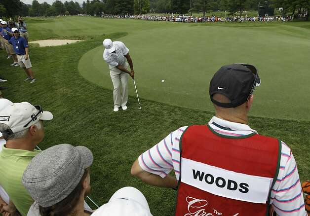 Tiger Woods chips up to the 2nd green during the first round of the Greenbrier Classic PGA Golf tournament at the Greenbrier in White Sulphur Springs, W. Va., Thursday, July 5, 2012.  (AP Photo/Steve Helber) Photo: Steve Helber, Associated Press