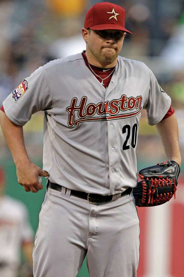 Astros pitcher Bud Norris can huff and puff, but he won't get that run back after giving up an RBI double in the second inning Thursday night. Photo: Gene J. Puskar / AP