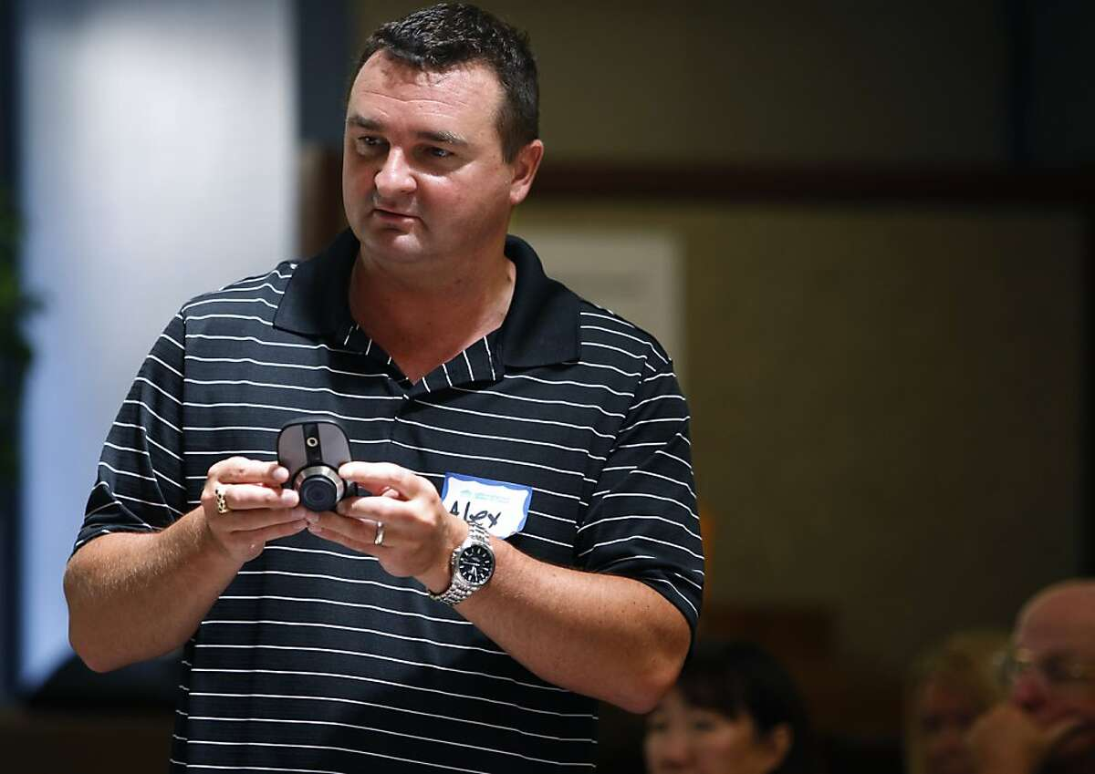 Alex Zaliauskas, demonstrates a home video surveillance system, devleoped by Logitech, at a home security workshop in Oakland, Calif. on Saturday, June 30, 2012. Concerned with soaring a crime rate, Oakland Hills residents are looking at security cameras as an effective crime-prevention measure.