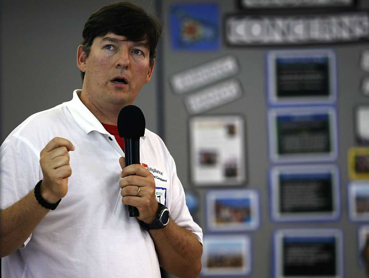 Jesper Jurcenoks describes the video surveillance system he organized in his neighborhood to record vehicle license plates at a workshop in Oakland, Calif. on Saturday, June 30, 2012. Concerned with soaring a crime rate, Oakland Hills residents are looking at security cameras as an effective crime-prevention measure.