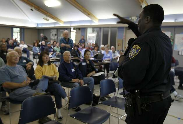 Oakland police services technician Eddie Simlin speaks to a group of residents at a home video surveillance system workshop in Oakland, Calif. on Saturday, June 30, 2012. Concerned with soaring a crime rate, Oakland Hills residents are looking at security cameras as an effective crime-prevention measure. Photo: Paul Chinn, The Chronicle