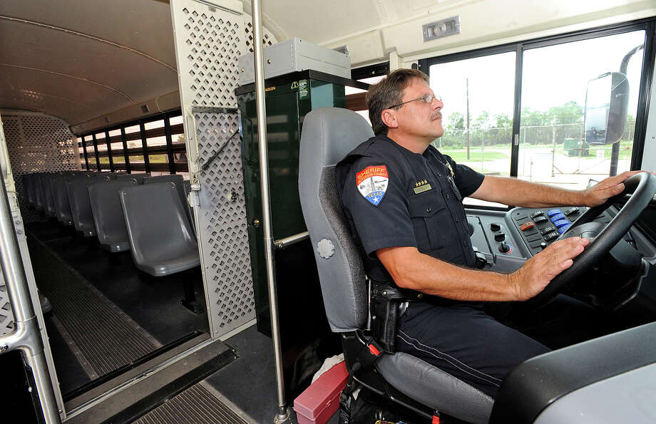 During a hurricane evacuation, the Jefferson County Sheriff's Office will use their bus and several school busses from the Port Neches-Groves School District to transport inmates to their downtown- Beaumont jail. Patrick Stelly drives the transport bus in the jail's parking lot on Monday. Photo taken Monday, July 2, 2012 Guiseppe Barranco/The Enterprise Photo: Guiseppe Barranco, STAFF PHOTOGRAPHER / The Beaumont Enterprise