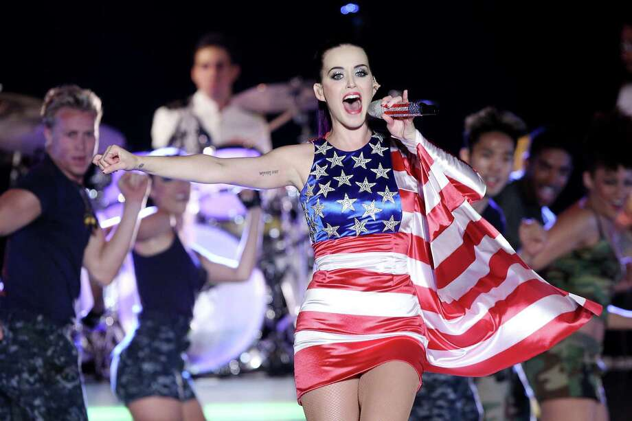 "FILE - In this May 23, 2012 file photo released by Starpix, singer Katy Perry wears a patriotic dress as she performs at a Pepsi-sponsored event at Brooklyn Pier 9A, kicking off  Fleet Week in New York. The pop star's energetic Day-Glo performances and chart success _ tying Michael Jackson's ""Bad"" with five No. 1 singles from her album ""Teenage Dream"" _ are undercut by heartbreak in her new 3D concert film ""Katy Perry: Part of Me."" She sobs uncontrollably backstage as her marriage to Russell Brand falls apart during her world tour, and talks about her dashed desire for ""fairy tale"" romance. The film opens nationwide on July 5. (AP Photo/Starpix, Amanda Schwab, file) Photo: Amanda Schwab, HOEP"