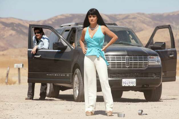 "This film image released by Universal Pictures shows Benicio Del Toro, left, and Salma Hayek in a scene from ""Savages."" (AP Photo/Universal Pictures, Francois Duhamel) Photo: Francois Duhamel, HOEP"