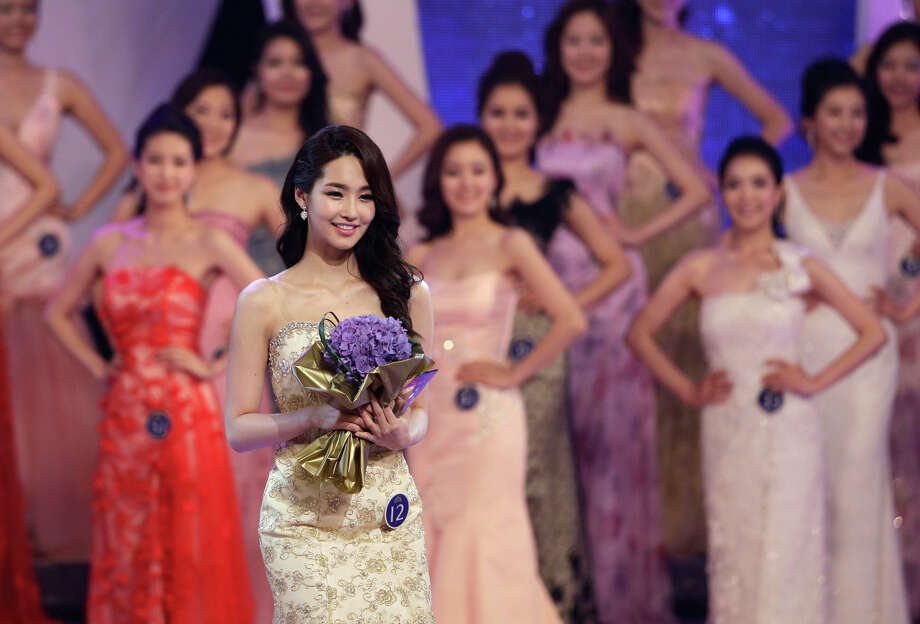 Winner Kim Yu-mi, a 22-year-old college student, greets audience during the 2012 Miss Korea Contest at the Kyunghee university in Seoul, South Korea, Friday, July 6, 2012. Kim will represent South Korea for this year's Miss Universe beauty pageant. (AP Photo/Lee Jin-man) Photo: Lee Jin-man, Associated Press / AP