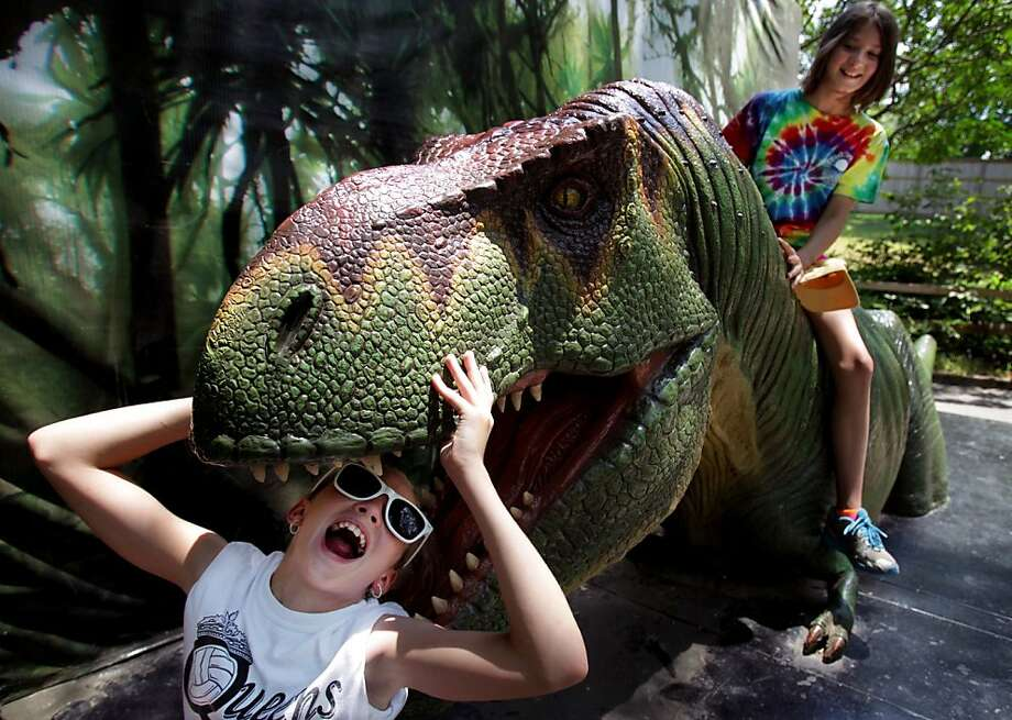 Feeding time at the Memphis Zoo: At the very least, you could stop smiling while your sister, Abby, is being devoured, Summer Wilson. Photo: Mike Brown, Associated Press