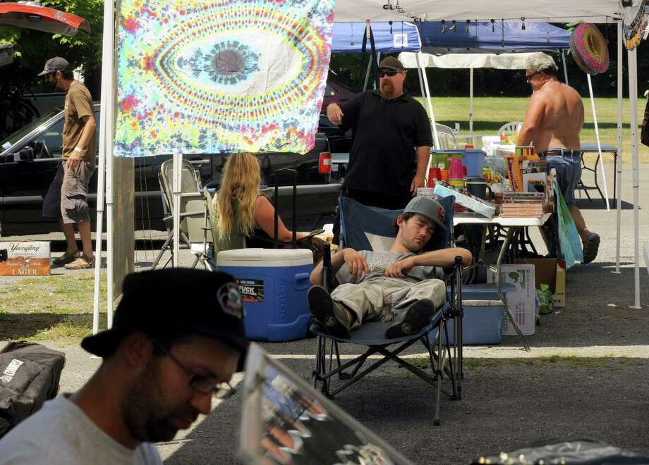 Vendors set up their booths Friday in preparation for the Phish concert at the Saratoga Performing Arts Center in Saratoga Springs. (Michael P. Farrell / Times Union) Photo: Michael P. Farrell