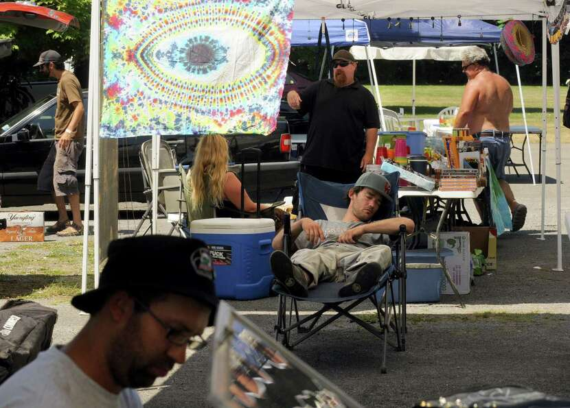 Vendors set up their booths Friday in preparation for the Phish concert at the Saratoga Performing A