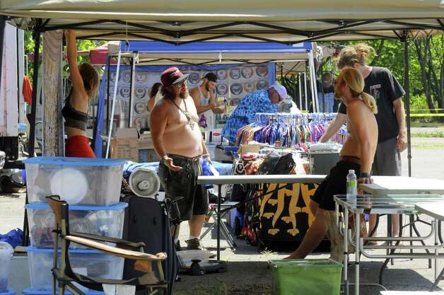Barry Cohen, center, and other vendors set up their booths Friday in preparation for the Phish concert at the Saratoga Performing Arts Center in Saratoga Springs. (Michael P. Farrell / Times Union) Photo: Michael P. Farrell