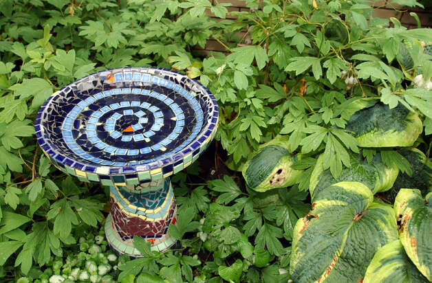 A bird bath provides water for birds and a focal point for the garden or landscape. Photo: Chicago Tribune / CHICAGO TRIBUNE