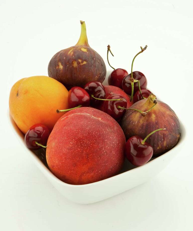 Fruits now in season: Apricots, cherries, peaches and figs. Photo: Nick De La Torre / © 2012  Houston Chronicle