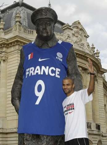 Tony Parker of the French National baseball team poses next to the Winston Churchill statue, dressed with the national shirt, to mark the upcoming Summer Olympic games in London, in Paris, Monday, Sept. 19, 2011. France silver medalist, lost against Spain in the EuroBasket European Basketball Championship final in Kaunas, Lithuania, Sunday Sept. 18, 2011.  (Michel Euler / Associated Press)