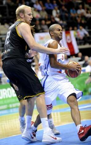 Tony Parker, right, of France vies with Chris Kaman of Germany during a 2011 European championship qualifying round, group B , basketball game in Siauliai on September 2, 2011.  (Janek Skarzynski / AFP/Getty Images)