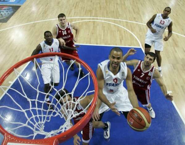 France's Tony Parker, with ball, is challenged by Turkey's players during their EuroBasket 2009, European Basketball Championships semi-final for 5th to 8th place match in Katowice, Poland, Saturday Sept. 19, 2009. (Darko Vojinovic / Associated Press)