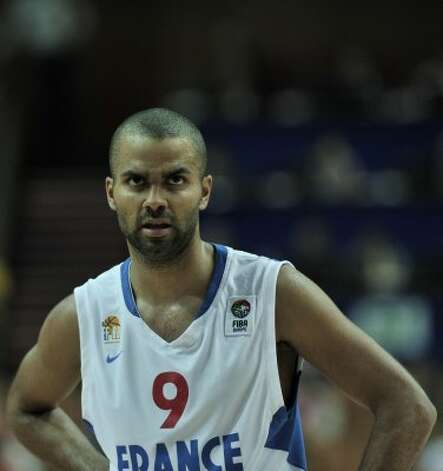 Tony Parker, center, looks on during their 2009 European Championship Basketball game against Spain in Katowice on September 17, 2009.  Spain Won 73-52. (Aris Messinis / AFP/Getty Images)