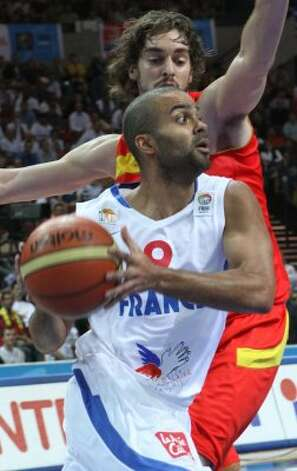 Tony Parker, front, of France is challenged by Pau Gasol, back, from Spain during the EuroBasket 2009, European Basketball Championships quarter-final match between France and Spain in Katowice, Poland, Thursday, Sept. 17, 2009. (Czarek Sokolowski / Associated Press)