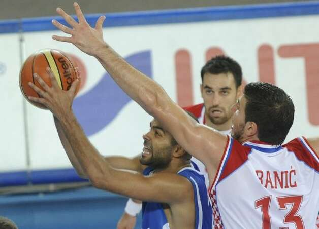 France's Tony Parker, left, is challenged by Croatia's Marko Banic during their EuroBasket 2009, European Basketball Championships group E qualifying round match in Bydgoszcz, Sunday, Sept. 13, 2009. (Alik Keplicz / Associated Press)