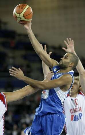 France's Tony Parker, center, is challenged by Croatia's players during their EuroBasket 2009, European Basketball Championships group E qualifying round match in Bydgoszcz, Poland, Sunday Sept. 13, 2009. (Darko Vojinovic / Associated Press)