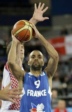 France's Tony Parker, center, is challenged by Croatia's Sandro Nicevic during their EuroBasket 2009, European Basketball Championships group E qualifying round match in Bydgoszcz, Poland, Sunday Sept. 13, 2009. (Darko Vojinovic / Associated Press)