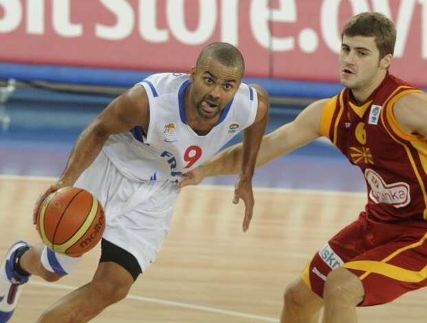 France's Tony Parker, left, challenges Darko Sokolov from F.Y.R of Macedonia during their EuroBasket 2009, European Basketball Championships group E qualifying round match in Bydgoszcz, Friday, Sept. 11, 2009.  (Alik Keplicz / Associated Press)