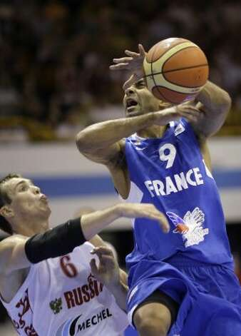 France's Tony Parker, right, is challenged by Russia's Sergey Bykov during their EuroBasket 2009, European Basketball Championships group B match in Gdansk, northern Poland, Wednesday Sept. 9, 2009. (Darko Vojinovic / Associated Press)