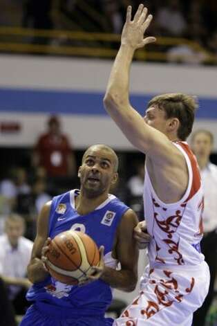 France's Tony Parker, left, is challenged by Russia's Aleksey Zozulin during their EuroBasket 2009, European Basketball Championships group B match in Gdansk, northern Poland, Wednesday Sept. 9, 2009. (Darko Vojinovic / Associated Press)