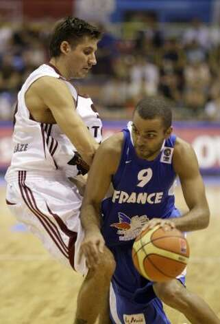 France's Tony Parker, right, is challenged by Latvia's Kristaps Valters during their EuroBasket 2009, European Basketball Championships group B match in Gdansk, northern Poland, Tuesday Sept. 8, 2009. (Darko Vojinovic / Associated Press)