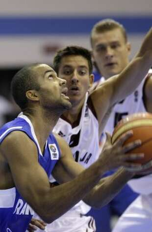 France's Tony Parker, front, is challenged by Latvia's Kristaps Valters during their EuroBasket 2009, European Basketball Championships group B match in Gdansk, northern Poland, Tuesday Sept. 8, 2009. (Darko Vojinovic / Associated Press)