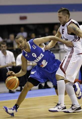 France's Tony Parker, left, is challenged by Latvia's Armands Skele during their EuroBasket 2009, European Basketball Championships group B match in Gdansk, northern Poland, Tuesday Sept. 8, 2009. (Darko Vojinovic / Associated Press)