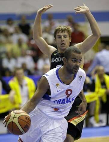 France's Tony Parker, front, is challenged by Germany's Heiko Schaffartzik during their EuroBasket 2009, European Basketball Championships group B match in Gdansk, northern Poland, Monday Sept. 7, 2009. (Darko Vojinovic / Associated Press)