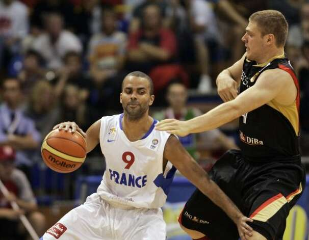 France's Tony Parker, left, is challenged by Germany's Lucca Staiger during their EuroBasket 2009, European Basketball Championships group B match in Gdansk, northern Poland, Monday Sept. 7, 2009. (Darko Vojinovic / Associated Press)