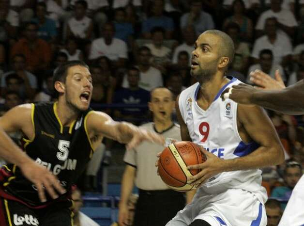 French NBA player Tony Parker, right, and unidentified Belgian player seen,  during the Euro 2009 basketball qualifying round France against Belgium, in Pau, southwestern France, Sunday, Aug. 30, 2009. France won  92 to 54 to qualify. (Fred Scheiber / Associated Press)
