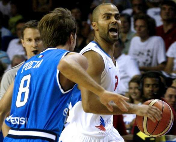 France's Tony Parker, right, on his way to the basket, clashes with Italy's, Guiseppe Poeta, left, in a Euro 2009 basketball qualifying round between France and Italy, in Pau, southwestern France on Friday, Aug. 14, 2009. (Bob Edme / Associated Press)