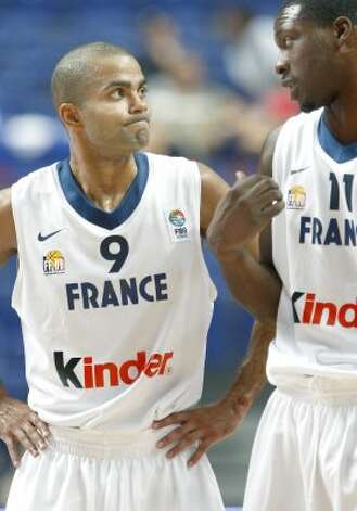 France's national basketball team player Tony Parker who plays in the U. S. for San Antonio Spurs, left, speaks with teammate Florent Pietrus, right, during their Classification Round 7th to 8th place game of the Eurobasket Championship against Slovenia in Madrid, Sunday Sept. 16, 2007. (Fernando Bustamante / Associated Press)