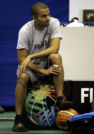 France's star player Tony Parker of the NBA's San Antonio Spurs watches his team's  practice session in Sendai, Japan, Friday Aug. 18, 2006. Parker will not play for France in the basketball world championships after being diagnosed with a broken finger.  Parker had X-rays of his right index finger in Japan on Thursday and found out Friday that it was broken. (Dusan Vranic / Associated Press)