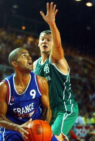 France's Tony Parker, left, goes to the basket under Sarunas Jasikevicius, of Lithuania, on the third and last day of the basketball European friendly tournament held in Strasbourg, eastern France, Sunday, Aug. 17, 2003. (Cedric Joubert / Associated Press)