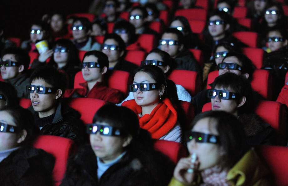 13. Looking at your phone during a movie. Photo: STR, Getty Images / 2010 AFP