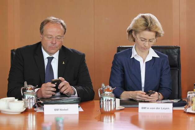 11. Two people texting at the same meeting. And giggling about it. Photo: Sean Gallup, Getty Images / 2012 Getty Images