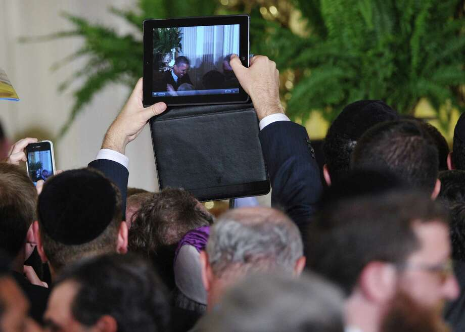 8. Blocking people's view at an event while you take a photo or video with your giant iPad. Worse if your giant iPad is in a case. Photo: MANDEL NGAN, Getty Images / 2012 AFP
