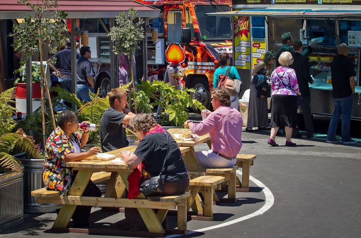 People eat their food during lunch time at the Streat Food Park in San Francisco, Calif., is seen on Thursday, June 28th, 2012.